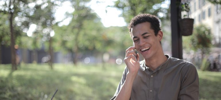 Smiling man talking on the phone with local movers MD.