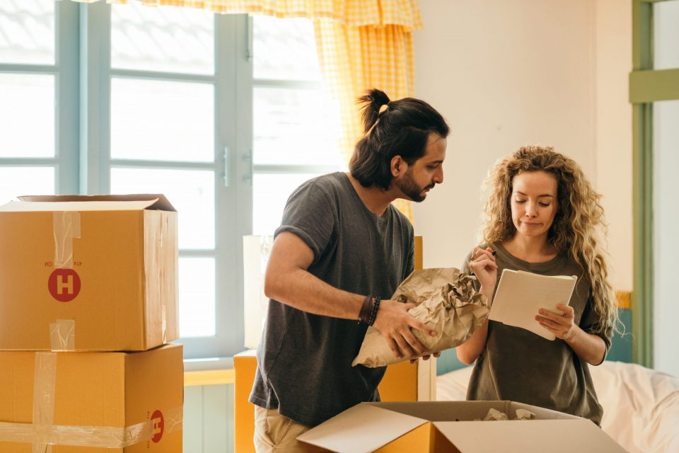 couple budgeting their move