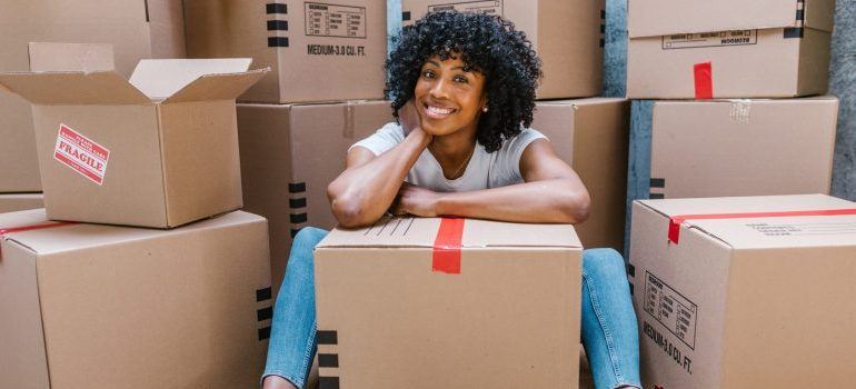 woman amidst moving boxes
