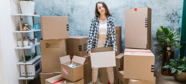A woman among moving boxes