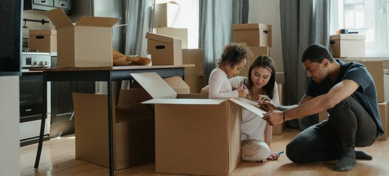 a family with moving boxes