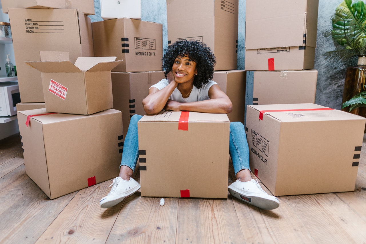 A woman siting among the boxes
