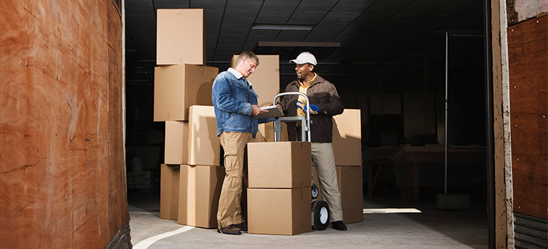 movers handling boxes