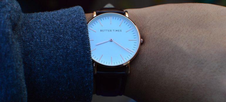 A person wearing a wrist watch.