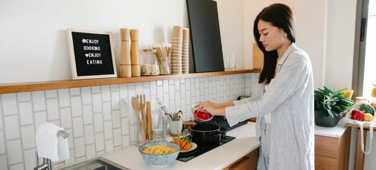 Woman is preparing home cooked meal after the move