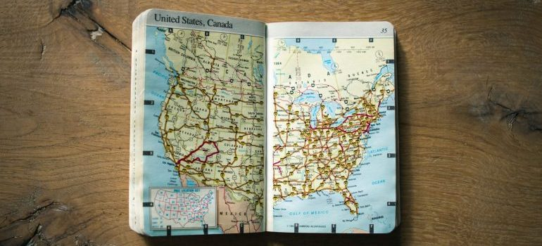 An atlas opened at the map of the US