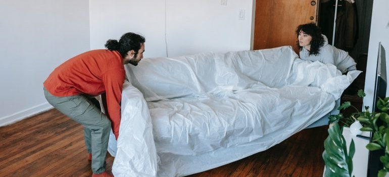 couple about to move bulky pieces of furniture
