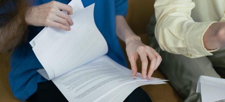 Woman browsing through moving documentation