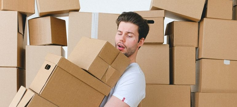 Man packing for moving from DC to NYC