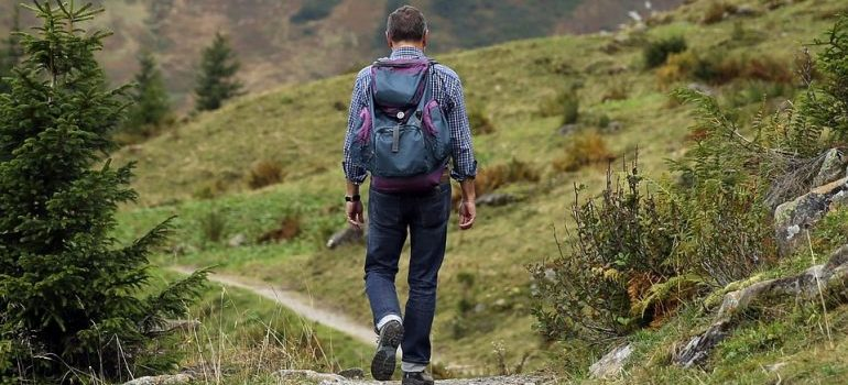 Man walking in the nature as moving to West Virginia means plenty of outdoor activities