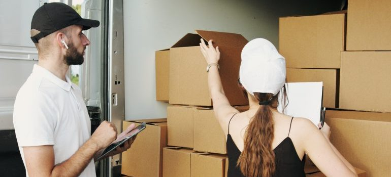 movers packing moving boxes