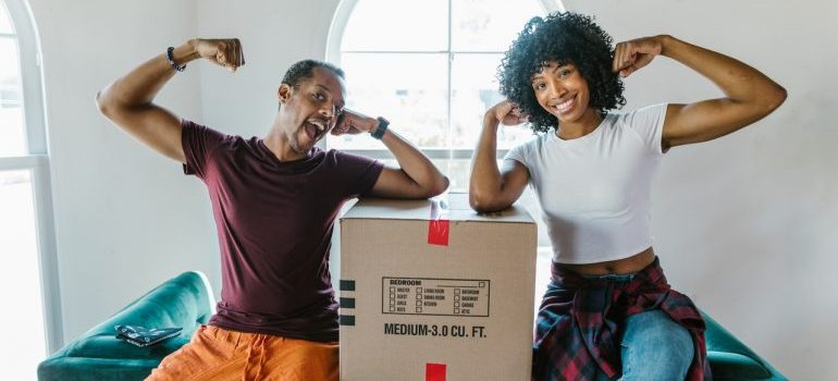 two people with a moving box