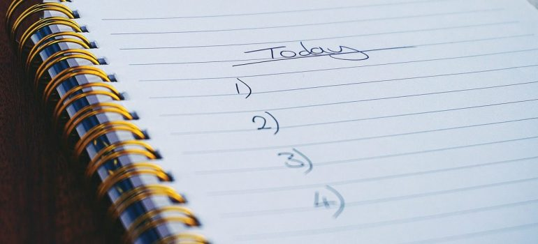 a checklist for today in a notebook representing how you should start creating your interstate move checklist