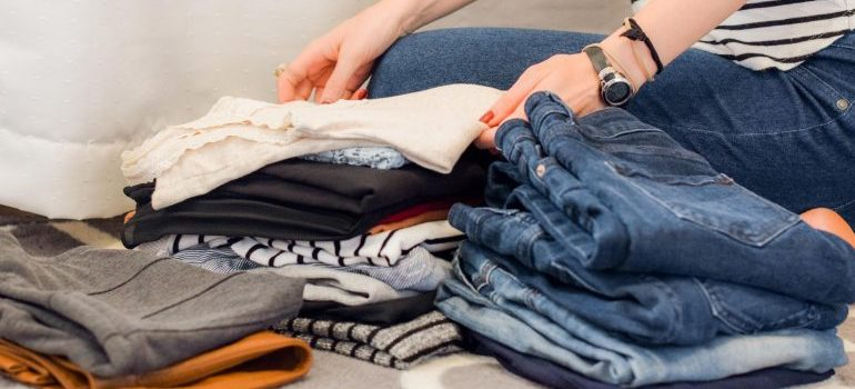 a girl decluttering her clothes
