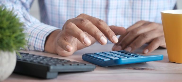 man calculating cost of Moving to West Virginia